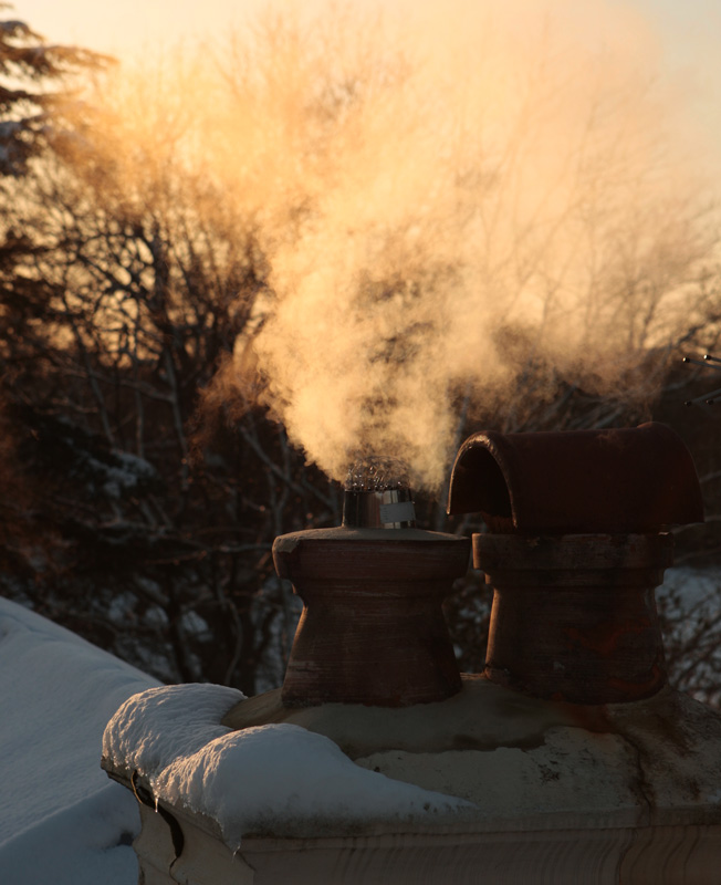 Condensing boiler vapour in the snow.